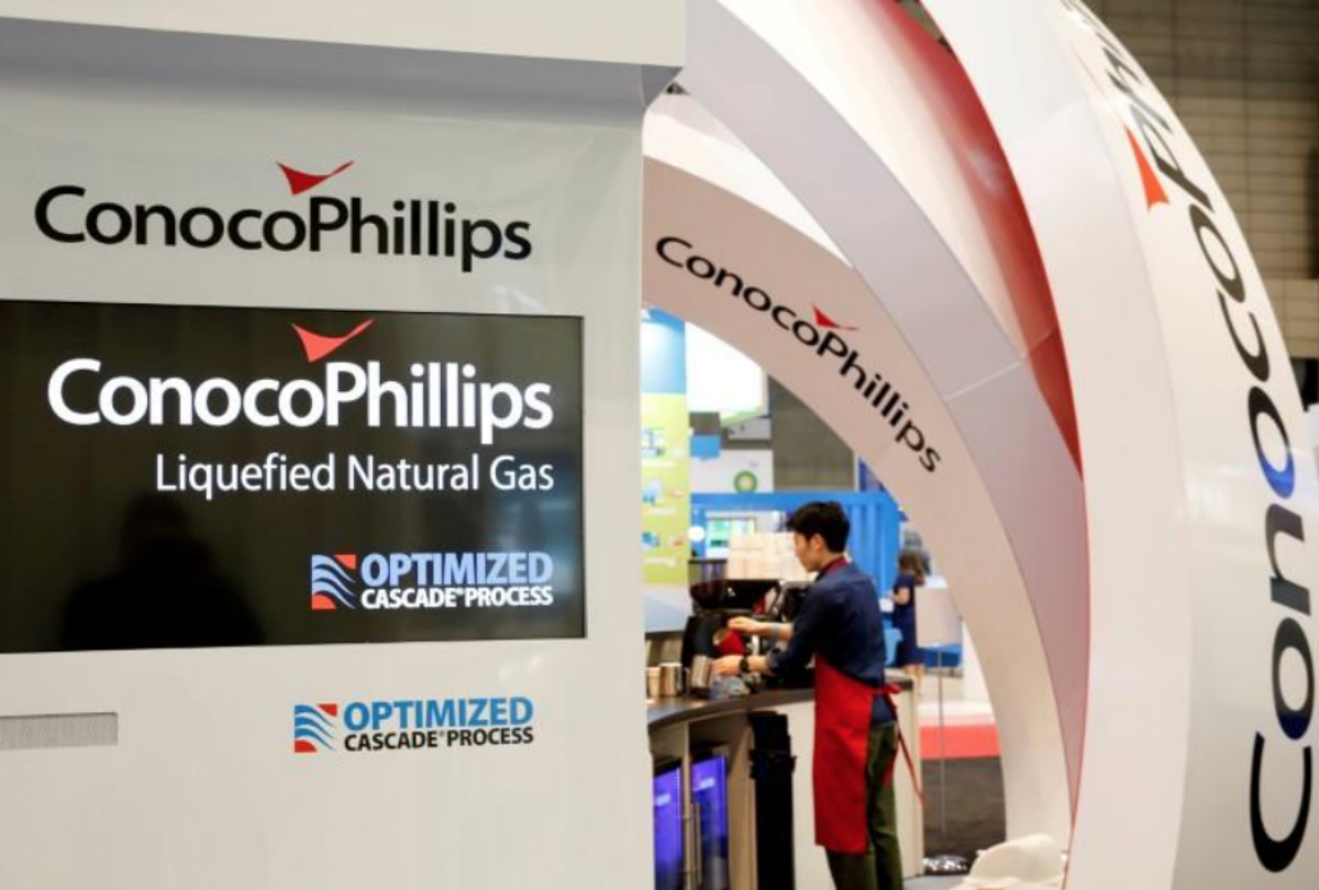 FILE PHOTO: Logos of ConocoPhillips are seen in its booth at Gastech, the world's biggest expo for the gas industry, in Chiba, Japan, April 4, 2017. REUTERS/Toru Hanai/File Photo - RC11AEA51EE0