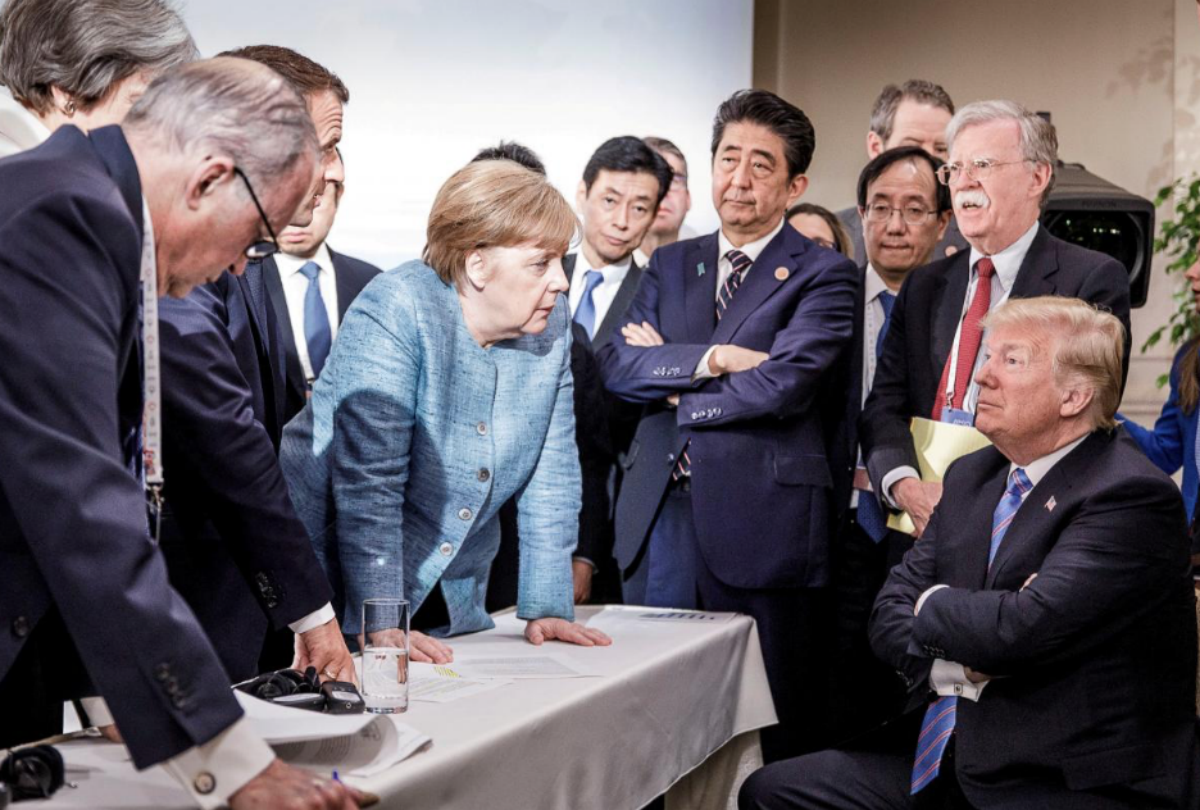 FILE PHOTO: German Chancellor Angela Merkel speaks to U.S. President Donald Trump during the second day of the G7 meeting in Charlevoix city of La Malbaie, Quebec, Canada, June 9, 2018. Bundesregierung/Jesco Denzel/Handout via REUTERS