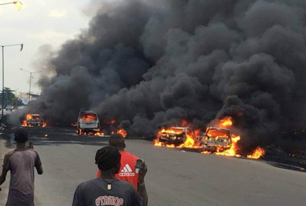 Smoke rises above the cars in fire on a street in Lagos, Nigeria, June 28, 2018 in this picture obtained from social media. RAPID RESPONSE SQUAD/via REUTERS