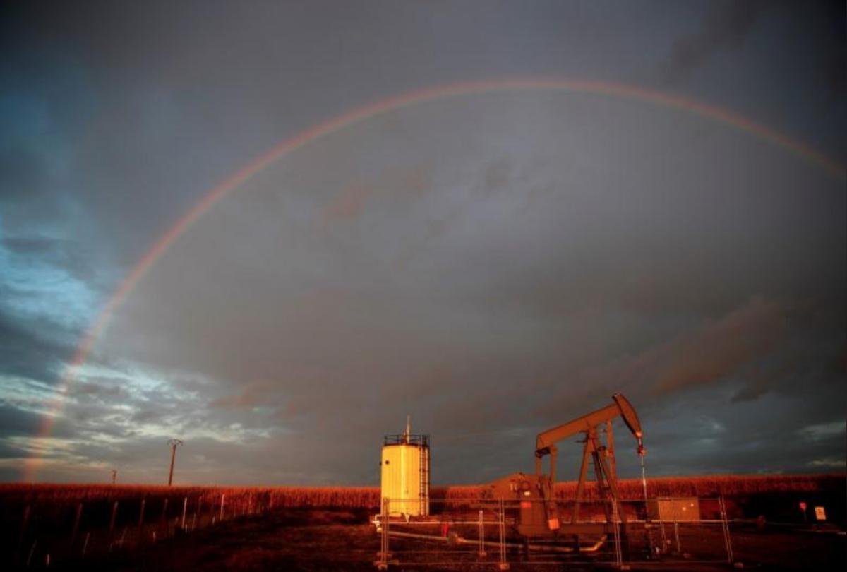 A rainbow is seen over a pumpjack during sunset outside Scheibenhard, near Strasbourg, France, October 6, 2017. REUTERS/Christian Hartmann