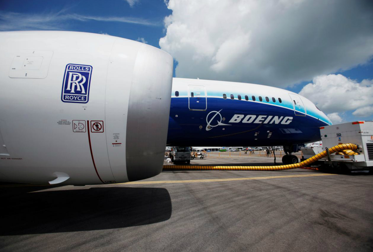 FILE PHOTO: A view of one of two Rolls Royce Trent 1000 engines of the Boeing 787 Dreamliner during a media tour of the aircraft ahead of the Singapore Airshow in Singapore February 12, 2012. REUTERS/Edgar Su/File Photo