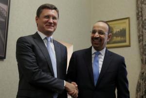 FILE PHOTO: Russian Energy Minister Alexander Novak and Saudi Arabian Energy Minister Khalid al-Falih shake hands ahead of a meeting in Moscow, Russia May 31, 2017. REUTERS/Maxim Shemetov/File Photo