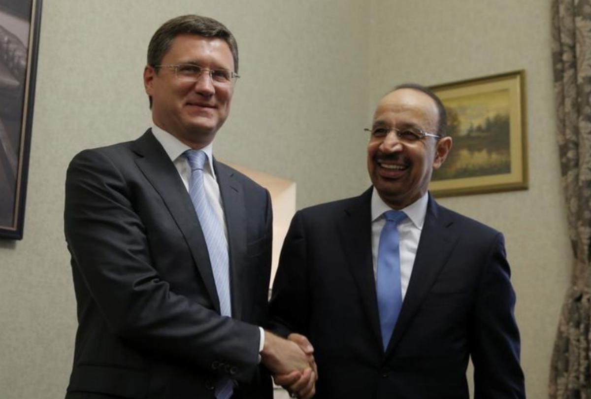 FILE PHOTO: Russian Energy Minister Alexander Novak and Saudi Arabian Energy Minister Khalid al-Falih shake hands ahead of a meeting in Moscow, Russia May 31, 2017. REUTERS/Maxim Shemetov/File Photo
