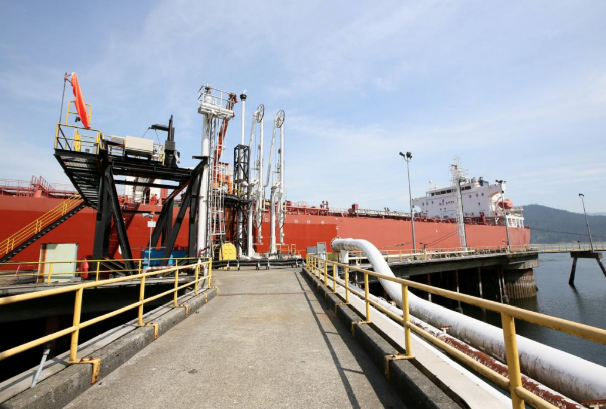 FILE PHOTO: A tanker docks at Westridge Terminal, the loading area for Kinder Morgan's Trans Mountain pipeline in Burnaby, British Columbia, Canada in a May 10, 2013 file photo. Kinder Morgan Canada/Handout/File Photo via REUTERS
