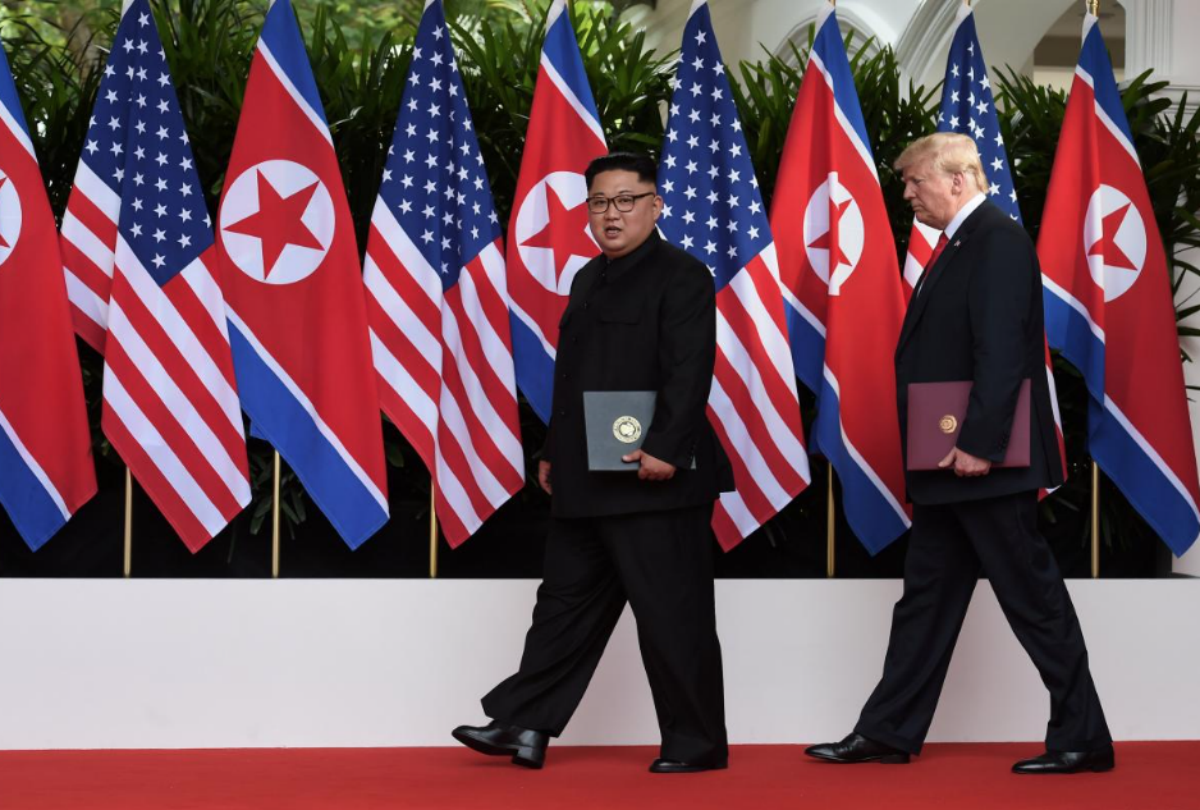 U.S. President Donald Trump and North Korea's leader Kim Jong Un walk during their summit at the Capella Hotel on Sentosa island in Singapore June 12, 2018. Anthony Wallace/Pool via Reuters