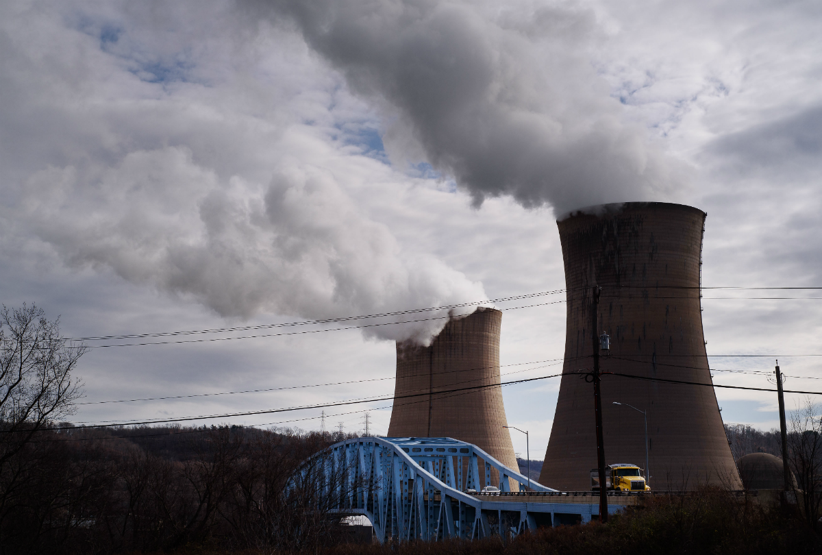 The FirstEnergy Corp. Beaver Valley nuclear power station stands next to the Shippingport Bridge in Shippingport, Pennsylvania, U.S., on Wednesday, Dec. 6, 2017. Across America, few places are as dominated by big, centralized power plants as Shippingport. It was here, in the 1950s, that the federal government teamed up with private industry to build the country's first nuclear power plant. Photographer: Justin Merriman/Bloomberg